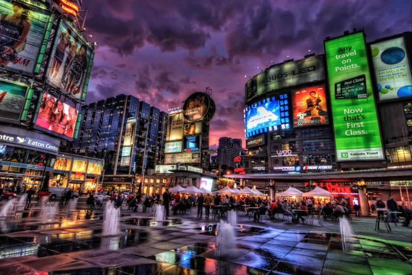 This is Toronto's Yonge-Dundas Square, which reminds me of Times Square in NY. I spent a couple of hours here and was lucky to get a colorful sunset. This is an HDR of 3 shots (-2, 0, +2), tonemapped in Photomatix. In PS: - Imagenomic Noiseware twice, one stronger on the sky. For the next commands I masked the sky. - Smart sharpen  - Freaky details masking - Nik Tonal Contrast - Vibrance increase on the whole image - A bit os saturation boost on the sky - Curves - Burn the top of the sky and the edges - A bit of Nik Glamour Glow.